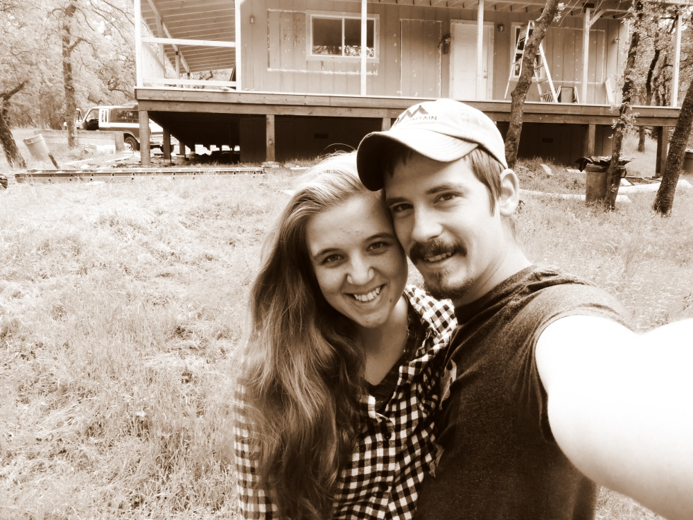 Standing in front of our almost completed home! Beautiful and that porch!!